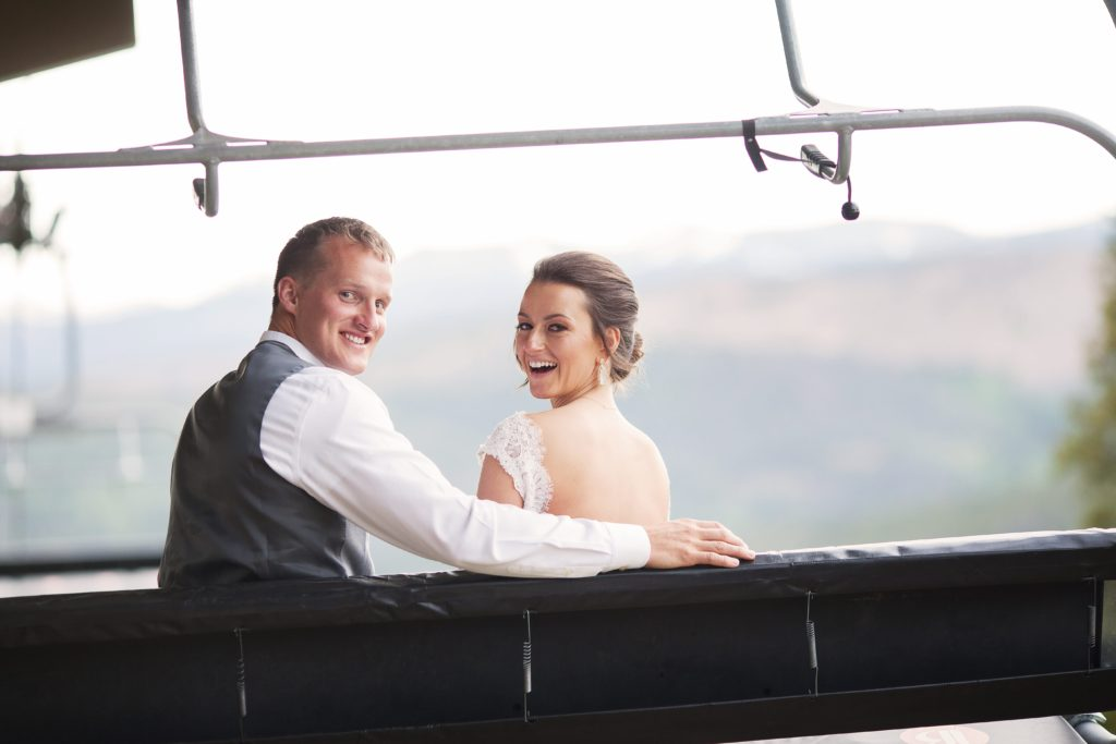 Bride and groom on ski lift in Breckenridge Colorado