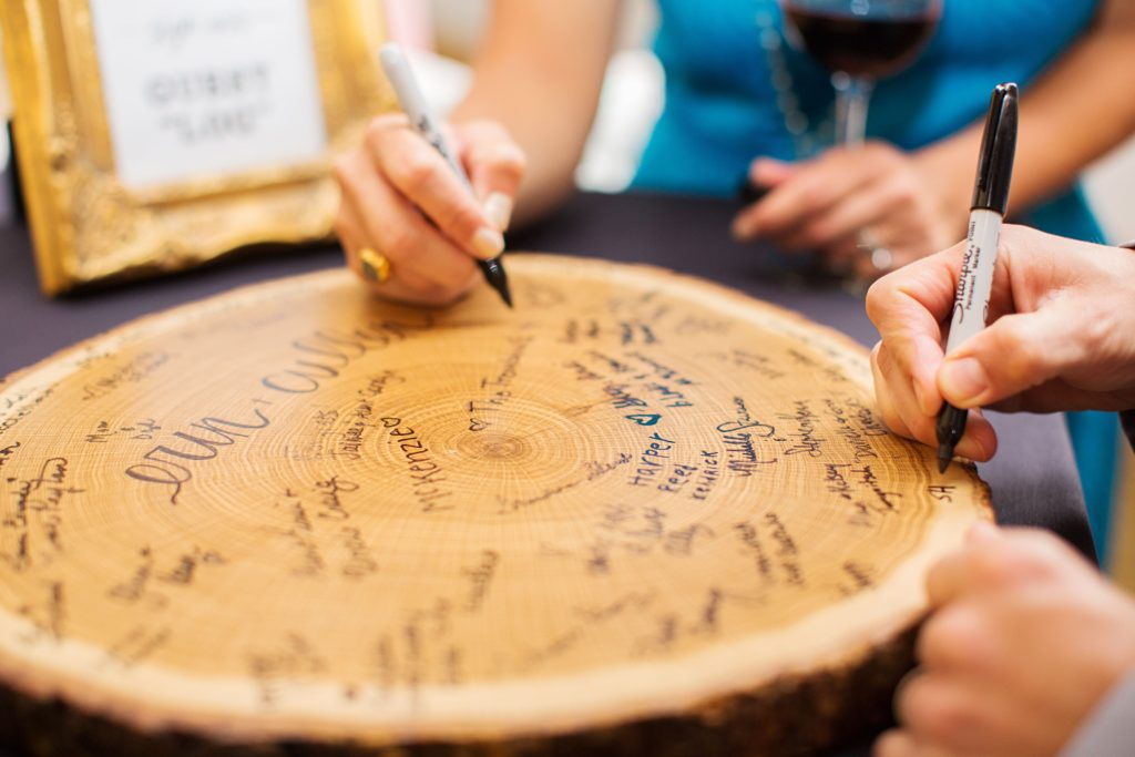Guests sign real wood guest log