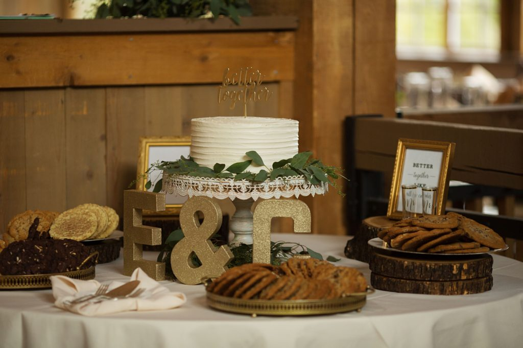 Wedding cake and cookies on dessert table