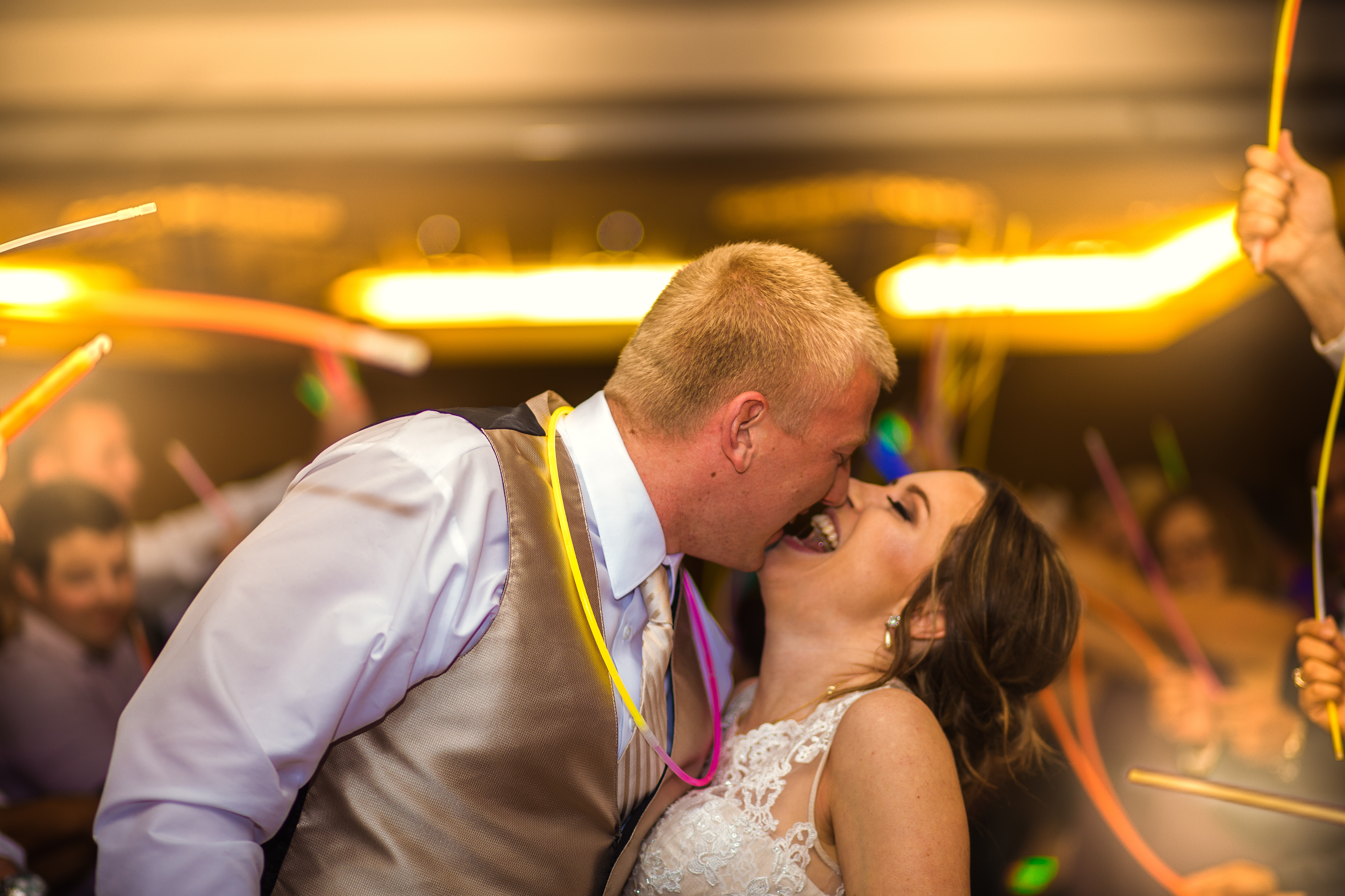 bride and groom dancing with glow sticks
