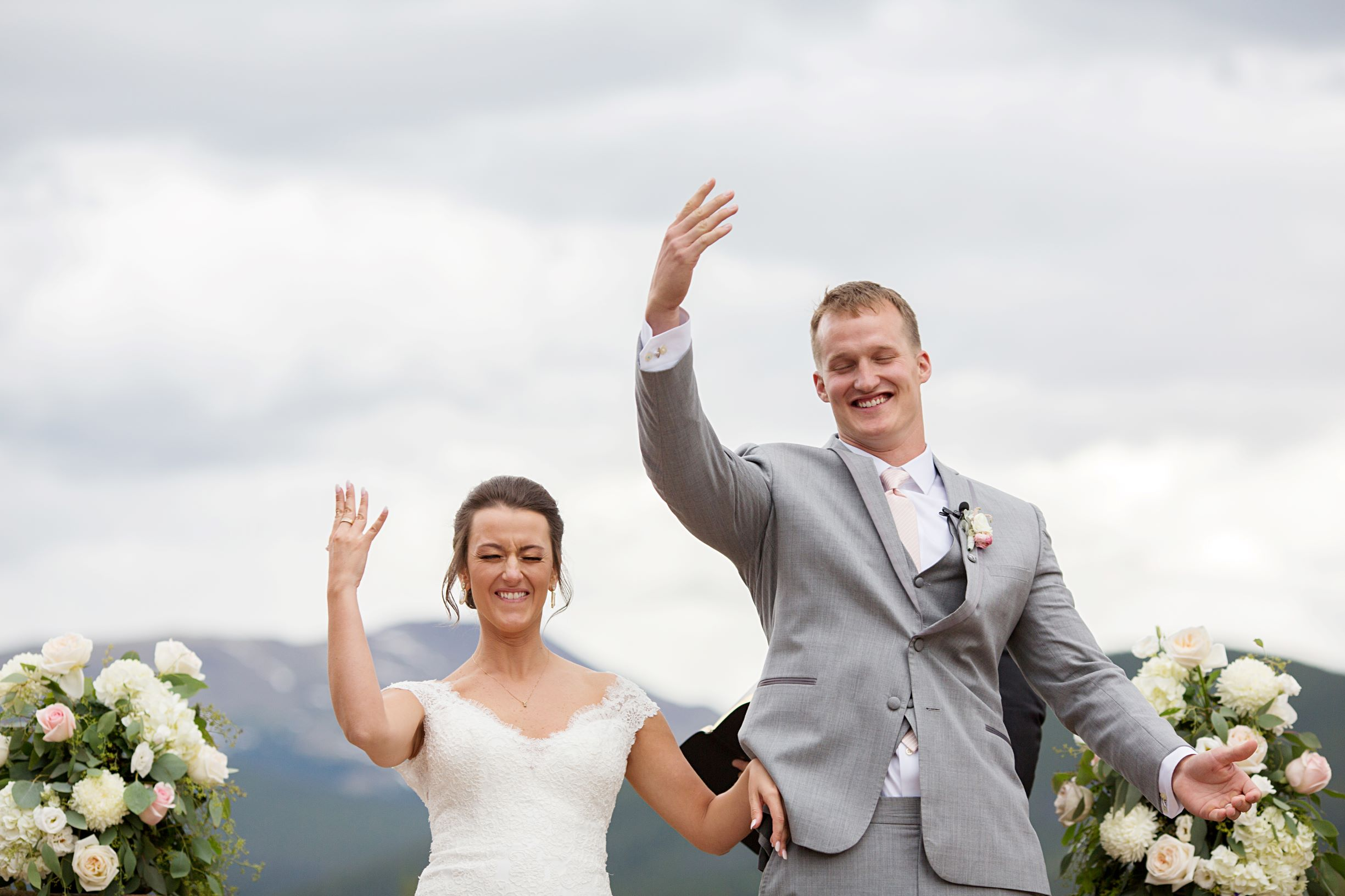 bride and groom tossing keys during unity ceremony