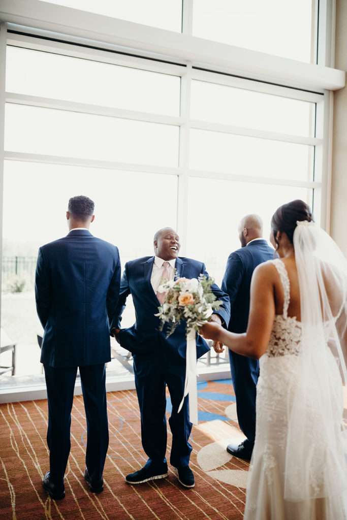 Father of the bride turns around with huge smile as he sees daughter for first time in wedding dress