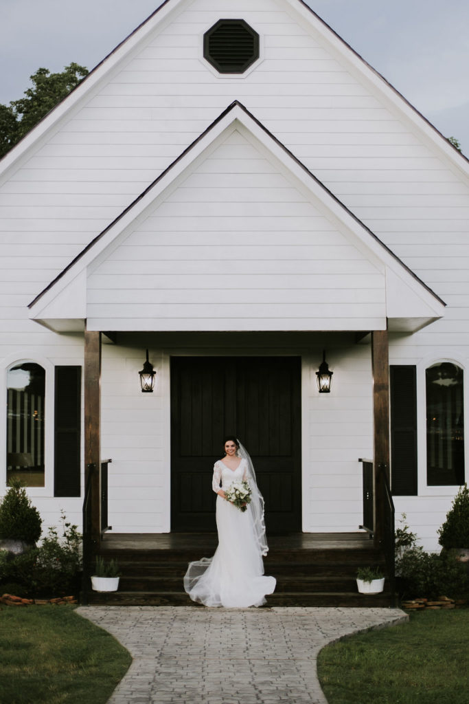 bride portrait in front of white chapel at Venue 311
