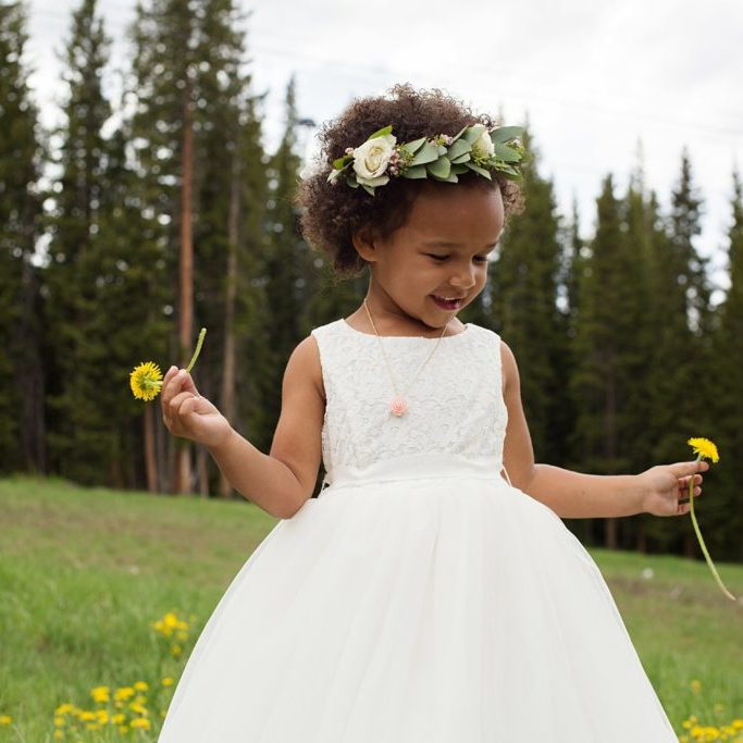 Flower girl picking flowers on mountainside