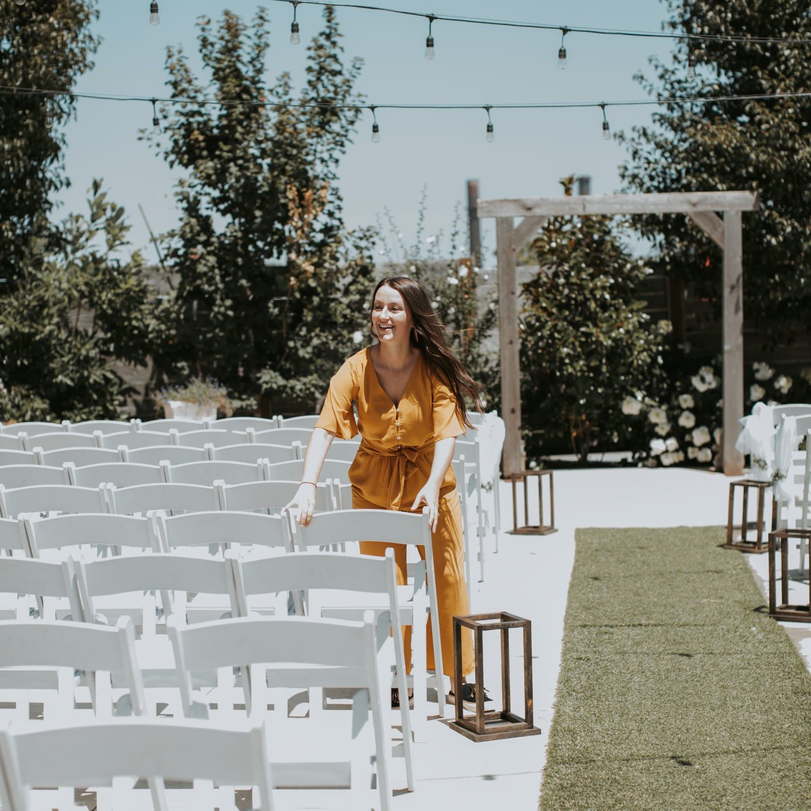 Houston wedding planner setting up ceremony chairs
